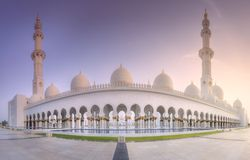 Sheikh Zayed Grand Mosque at sunset Abu-Dhabi, UAE. View of Sheikh Zayed Grand Mosque during purple sunset with pink sunbeams, Abu-Dhabi, UAE Stock Images