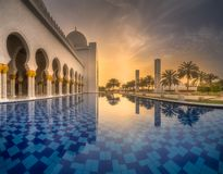 View of Sheikh Zayed Grand Mosque from water. Reflection at dusk, Abu-Dhabi, UAE Royalty Free Stock Photography