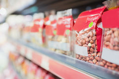 View of shelves with nuts. In the supermarket Royalty Free Stock Image