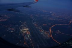 View of Moscow sheremetyevo airport lights from a Plane Window stock images