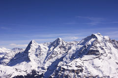 View from Shilthorn in Switzerland. Swiss alps mountain in winter with blue sky Stock Images
