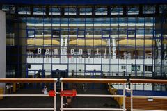 View from a ship of cruise terminal in Bari with a wall made of mirror reflecting Costa Deliziosa cruise ship with lifeboats. View from a ship of cruise terminal stock photo
