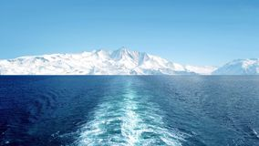 View From Ship In Frozen Landscape. POV from ship sailing away from huge glacial landmass stock footage