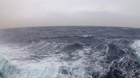 View from a ship moving along the waves in a strong storm in the Red Sea stock video footage