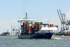 View of a ship in the Port of Hamburg and the Elbe. HAMBURG, GERMANY - JUNE 4, 2016: View of a ship in the Port of Hamburg and the Elbe river on June 4, 2016. It Stock Image