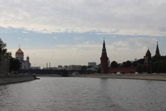 View from the ship to the Cathedral of Christ the Savior, the Vodovzvodnaya Tower of the Moscow Kremlin and the Bolshoy Kamenny Br. Idge in Moscow in the summer stock images