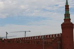 View from the ship to the red brick wall of the Moscow Kremlin with towers in the summer in Moscow. 2017 year royalty free stock image