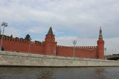 View from the ship to the red brick wall of the Moscow Kremlin with towers in the summer in Moscow. 2017 year stock photos