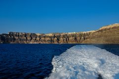 View from the ship to the sea and Santorini Island stock images