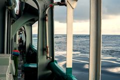 View from ship or vessel deck to open sea - heavy duty work at sea.  royalty free stock image