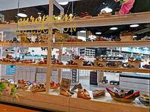 Shoe Shop Window. View of a shoe shop in a modern retail mall, with womens shoes displayed in the window and inside Stock Image