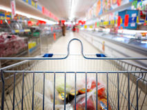 View of a shopping cart with grocery items Stock Photo