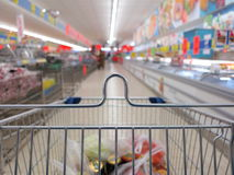View of a shopping cart with grocery items Royalty Free Stock Photography