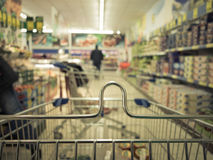 View from shopping cart trolley at supermarket shop. Retail. Stock Photo