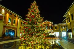 View of shopping center by night in Italy on Chistmas time. View of  shopping center in Italy on Chistmas time Royalty Free Stock Image