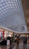A view of a shopping center with transparent glass ceiling. Chadstone, VIC / Australia - July 25 2018: A view of a shopping center with transparent square royalty free stock images