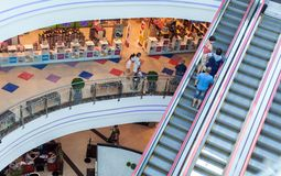 View on the shopping mall and people on escalator Stock Photo
