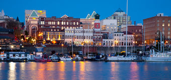View of shops along Inner Harbour, Victoria, BC at night Royalty Free Stock Image