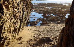 View of shore from entrance to sea cave at Fishermans Cove Beach in Laguna Beach, California. Royalty Free Stock Images