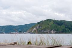 View from the shore of Lake Baikal to the mountain and village stock images