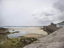 View of the shore from saint malo. On a cloudy day Royalty Free Stock Photo