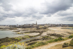 View of the shore from saint malo. On a cloudy day Stock Images