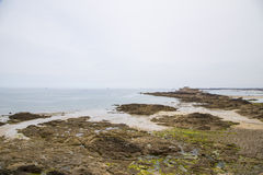 View of the shore from saint malo. On a cloudy day Royalty Free Stock Image