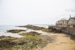 View of the shore from saint malo. On a cloudy day Royalty Free Stock Images