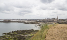 View of the shore from saint malo. On a cloudy day Stock Photos