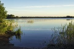 View from the shore to the lake in summer stock photo