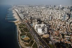 view from the shore to the modern district of Tel Aviv. Top view of the capital of Israel. Clean beautiful beach in the city stock images