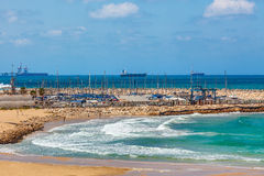 View on shoreline and marina in Israel. View on wavy Mediterranean sea, shoreline and marina on background on summer day in Ashqelon, Israel Royalty Free Stock Photo