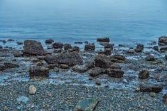 Shoreline Rocks At Low Tide Stock Photo