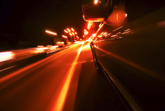 View from Side of Car Going Blurred Motion. Speedy driving by night. Police Car chase Royalty Free Stock Photo