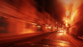 View from Side of Car Going Blurred Motion. Speedy driving by night. Police Car chase Royalty Free Stock Images