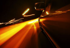 View from Side of Car Going Blurred Motion. Speedy driving by night. Police Car chase Stock Photos