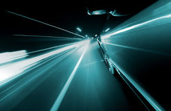 View from Side of Car Going Blurred Motion. Speedy driving by night. Police Car chase Stock Image