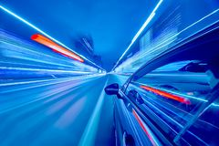 View from Side of Car moving in a night city. Blured road with lights with car on high speed. Concept rapid rhythm of a modern city royalty free stock photo