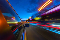 View from Side of Car moving in a night city. Royalty Free Stock Images