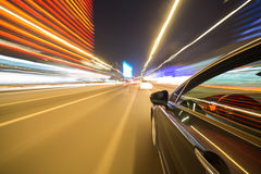 View from Side of Car moving in a night city Stock Image