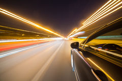 View from Side of Car moving in a night city Stock Photos