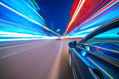 View from Side of Car moving in a night city Stock Photo