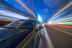 View from Side of Car moving in a night city Royalty Free Stock Photo