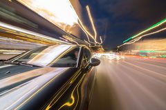 View from Side of Car moving in a night city Stock Photography