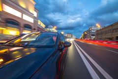 View from Side of Car moving in a night city Royalty Free Stock Image