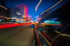 View from Side of Car moving in a night city Royalty Free Stock Images