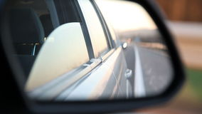View of a side car's mirror stock footage