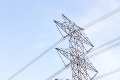 View side of high voltage poles in blue sky Royalty Free Stock Photography