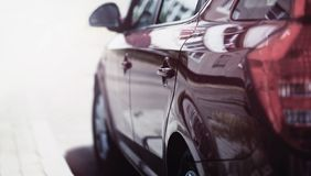 View side of luxury sport car rides on the road. Closeup Royalty Free Stock Images