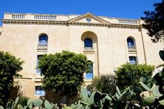 Malta maritime museum buildings, Vittoriosa. View of the side of the Malta maritime museum with prickly pear cactus in the foreground, Vittoriosa, Malta, Europe Royalty Free Stock Photo